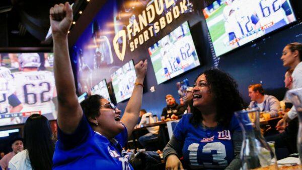 People watching football at bar